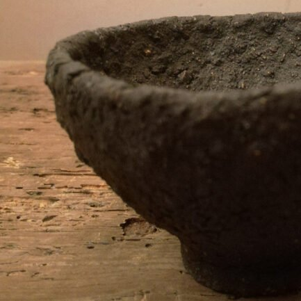 Small unglazed black clay bowl