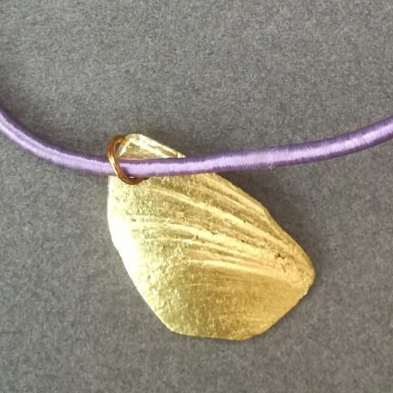 Gold shell pendant with lilac cord - detail